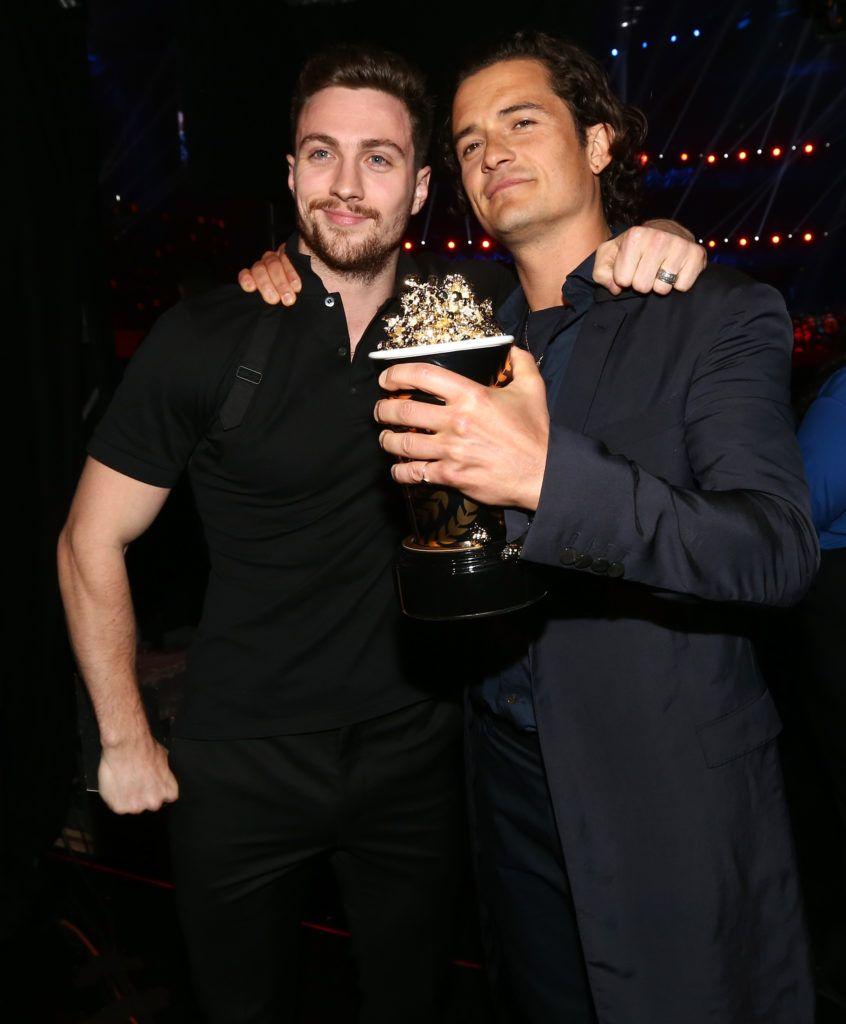 Aaron Johnson and Orlando Bloom attend the 2014 MTV Movie Awards at Nokia Theatre L.A. Live on April 13, 2014 in Los Angeles, California.  (Photo by Christopher Polk/Getty Images)