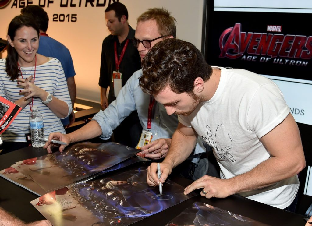 "Actors Paul Bettany (L) and Aaron Taylor-Johnson attend Marvel's ""Avengers: Age Of Ultron"" Hall H Panel Booth Signing during Comic-Con International 2014 at San Diego Convention Center on July 26, 2014 in San Diego, California.  (Photo by Alberto E. Rodriguez/Getty Images for Disney)"