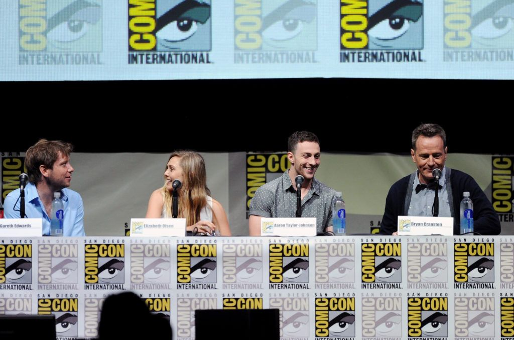 "Director Gareth Edwards, actress Elizabeth Olsen, actor Aaron Taylor-Johnson and actor Bryan Cranston speak onstage at the Warner Bros. and Legendary Pictures preview of ""Godzill"" during Comic-Con International 2013 at San Diego Convention Center on July 20, 2013 in San Diego, California.  (Photo by Kevin Winter/Getty Images)"