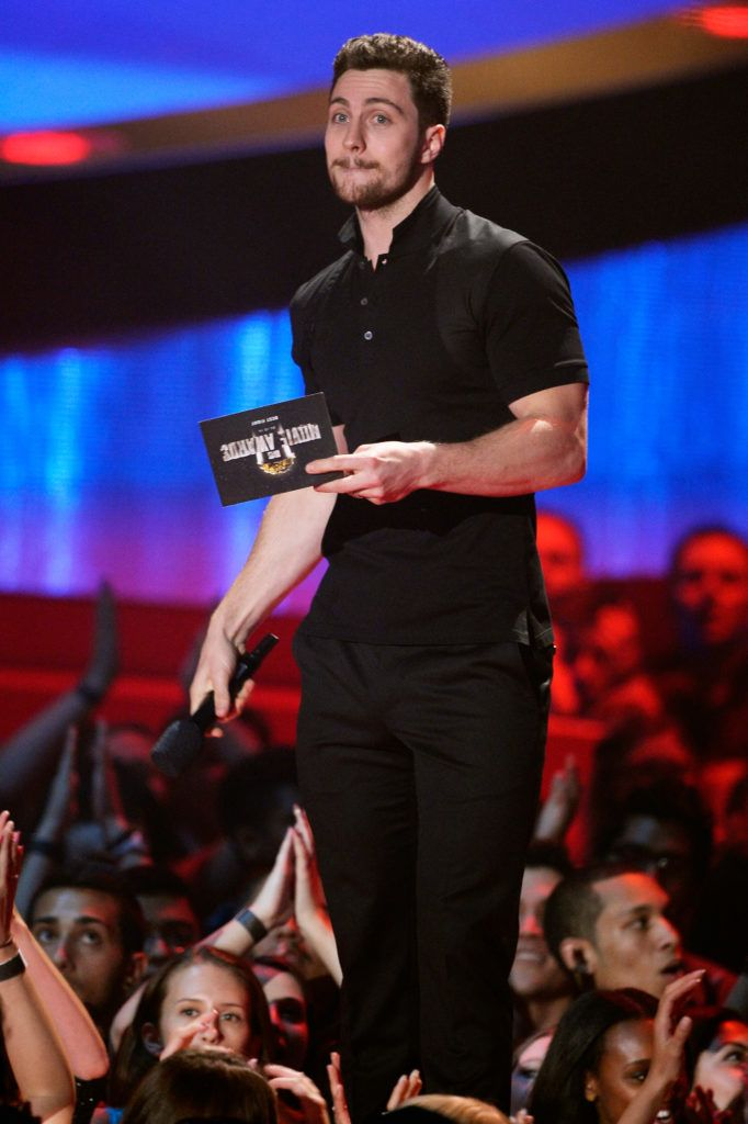 Actor Aaron Taylor-Johnson speaks onstage at the 2014 MTV Movie Awards at Nokia Theatre L.A. Live on April 13, 2014 in Los Angeles, California.  (Photo by Kevork Djansezian/Getty Images for MTV)