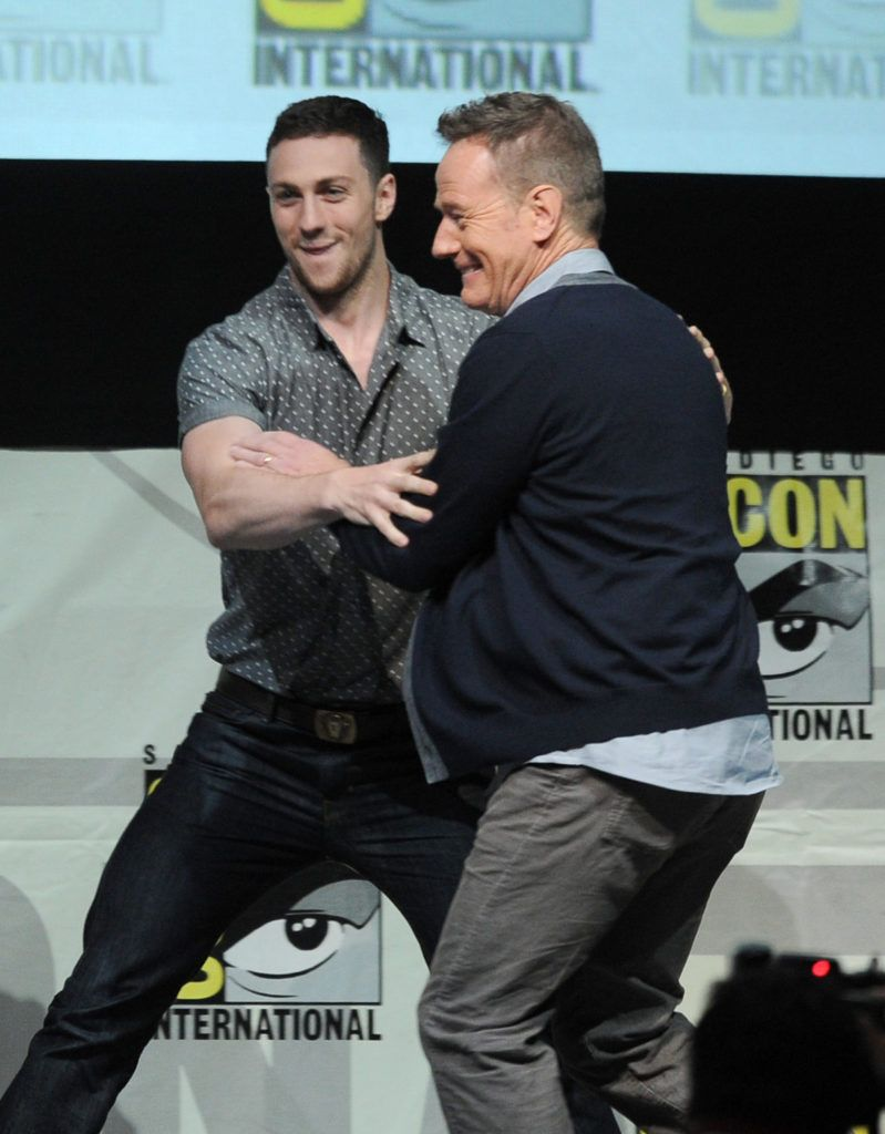 "Actor Aaron Taylor-Johnson (L) and actor Bryan Cranston speak onstage at the Warner Bros. and Legendary Pictures preview of ""Godzilla"" during Comic-Con International 2013 at San Diego Convention Center on July 20, 2013 in San Diego, California.  (Photo by Kevin Winter/Getty Images)"