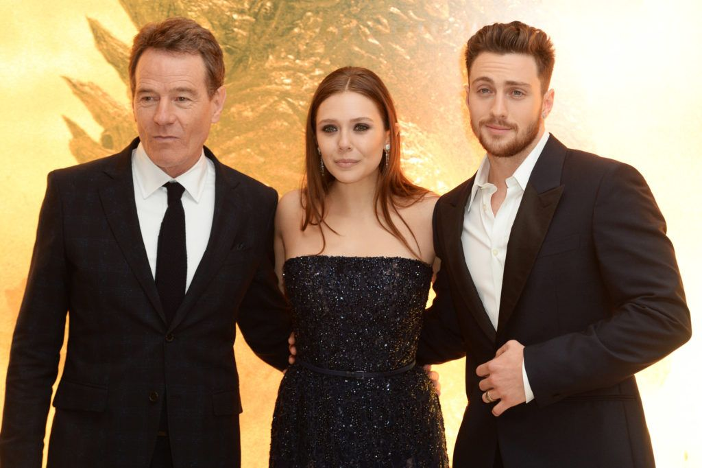 Bryan Cranston, Elizabeth Olsen and Aaron Taylor Johnson attend the European premiere of 'Godzilla' at the Odeon Leicester Square on May 11, 2014 in London, England.  (Photo by Dave J Hogan/Getty Images)