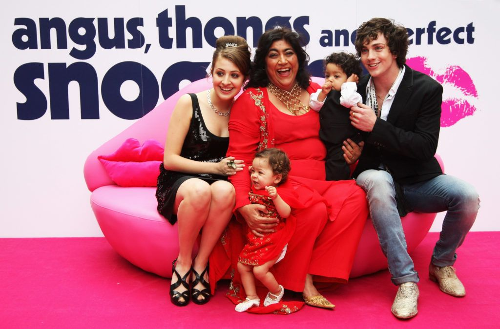 Actress Georgia Groome, Director Gurinder Chadha and her two children and Aaron Johnson pose for a photograph at the Empire Leicester Square during the UK Premiere of her film, Angus, Thongs and Perfect Snogging on July 16, 2008 in London, England.  (Photo by Chris Jackson/Getty Images)
