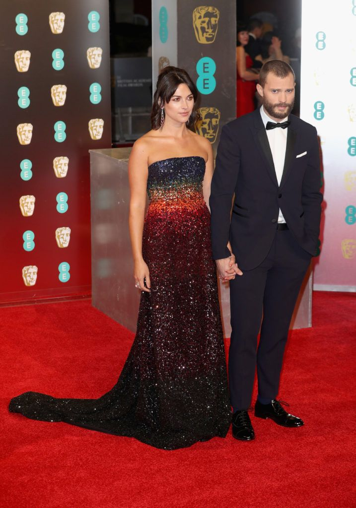 LONDON, ENGLAND - FEBRUARY 12:  Amelia Warner and Jamie Dornan attend the 70th EE British Academy Film Awards (BAFTA) at Royal Albert Hall on February 12, 2017 in London, England.  (Photo by Chris Jackson/Getty Images)