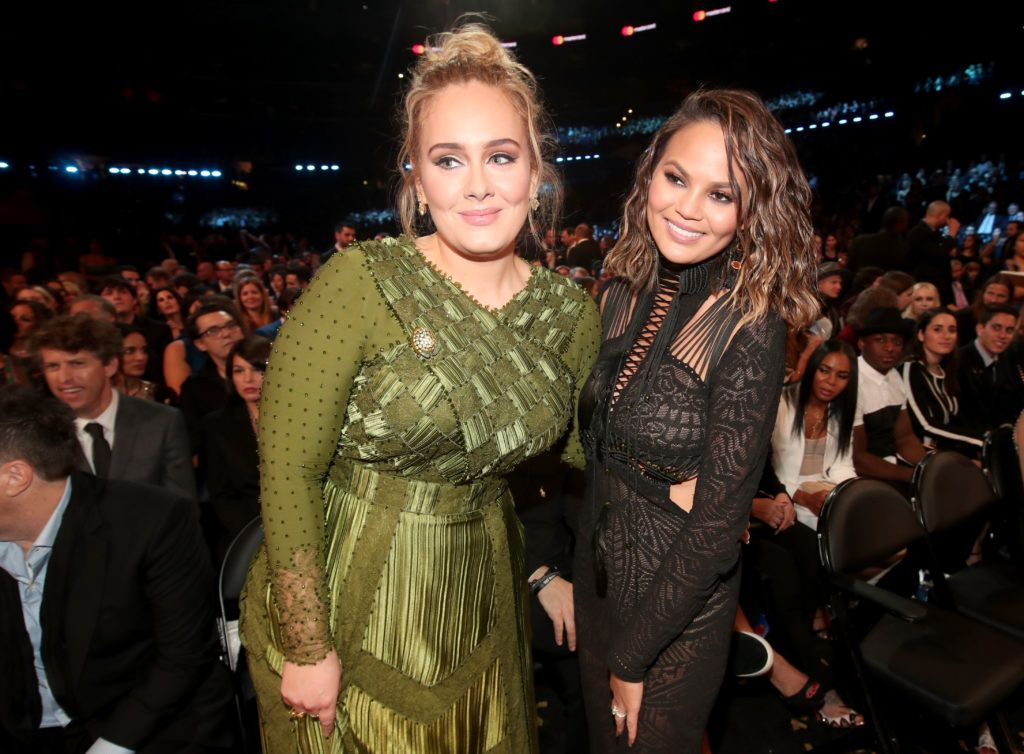 LOS ANGELES, CA - FEBRUARY 12:  Singer Adele (L) and media personality Chrissy Teigen during The 59th GRAMMY Awards at STAPLES Center on February 12, 2017 in Los Angeles, California.  (Photo by Christopher Polk/Getty Images for NARAS)