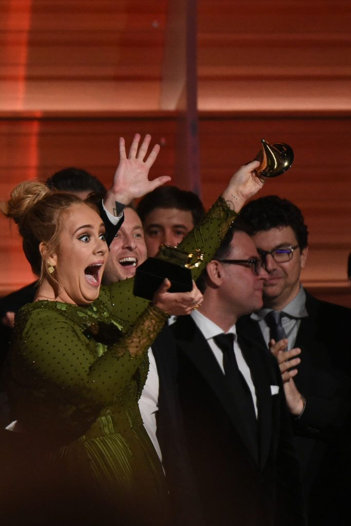 Adele celebrates her Grammys' awards including Best record and Best album of the year  performs onstage during the 59th Annual Grammy music Awards on February 12, 2017, in Los Angeles, California.   (Photo VALERIE MACON/AFP/Getty Images)