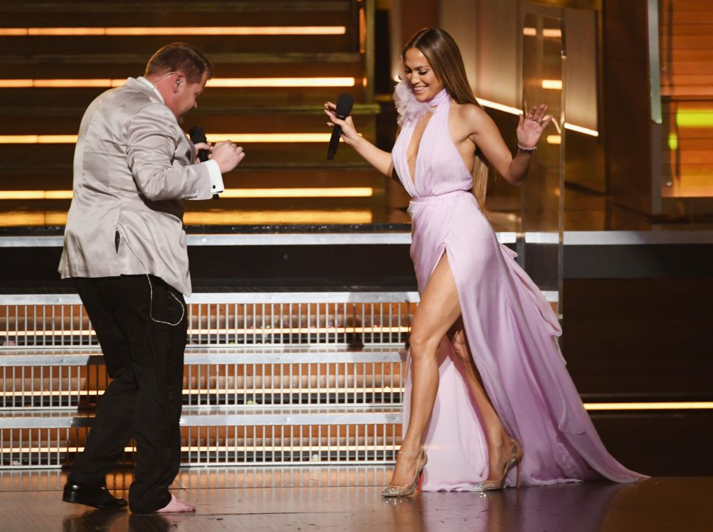 LOS ANGELES, CA - FEBRUARY 12:  Host James Corden (L) greets recording artist-actor Jennifer Lopez onstage during The 59th GRAMMY Awards at STAPLES Center on February 12, 2017 in Los Angeles, California.  (Photo by Kevin Winter/Getty Images for NARAS)