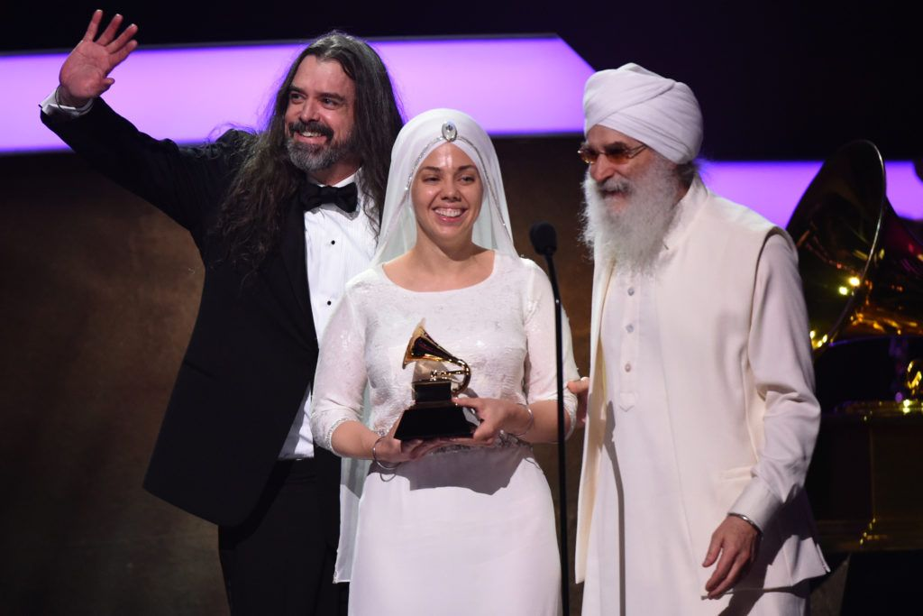Members of New Age group White Sun acknowledge their Grammy onstage during the 59th Annual Grammy music Awards pre-telecast on February 12, 2017, in Los Angeles, California.  (Photo VALERIE MACON/AFP/Getty Images)