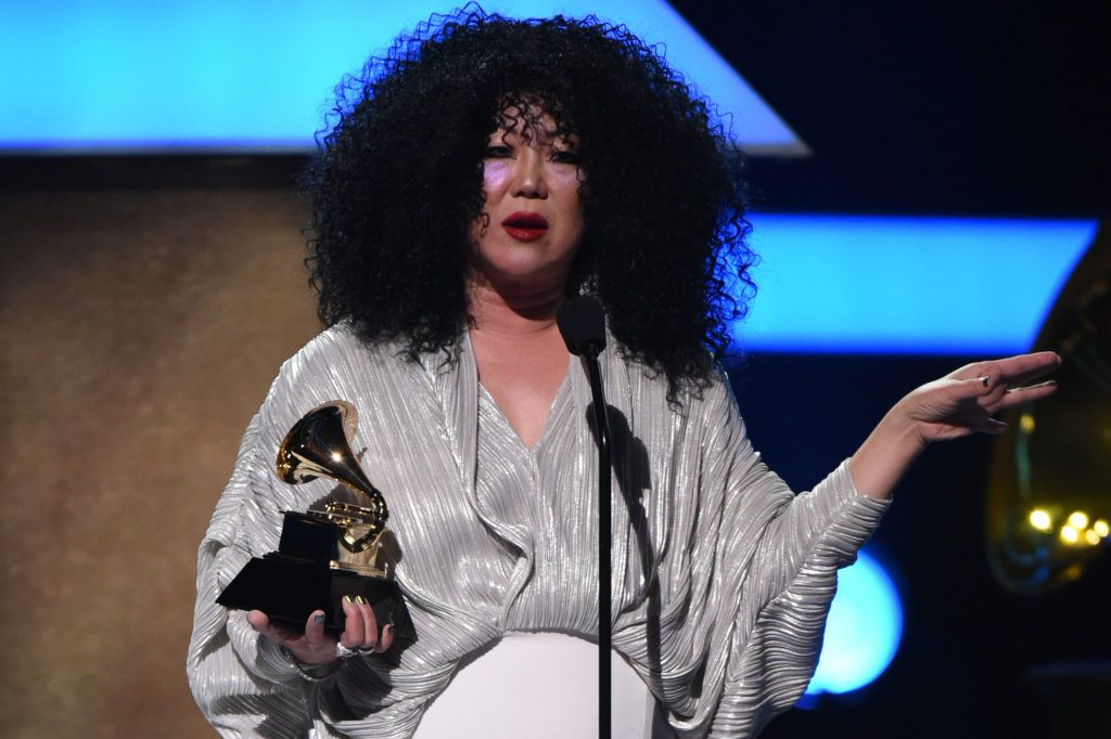 Host Margaret Cho  holds a Grammy award during the 59th Annual Grammy music Awards pre-telecast on February 12, 2017, in Los Angeles, California.   (Photo VALERIE MACON/AFP/Getty Images)