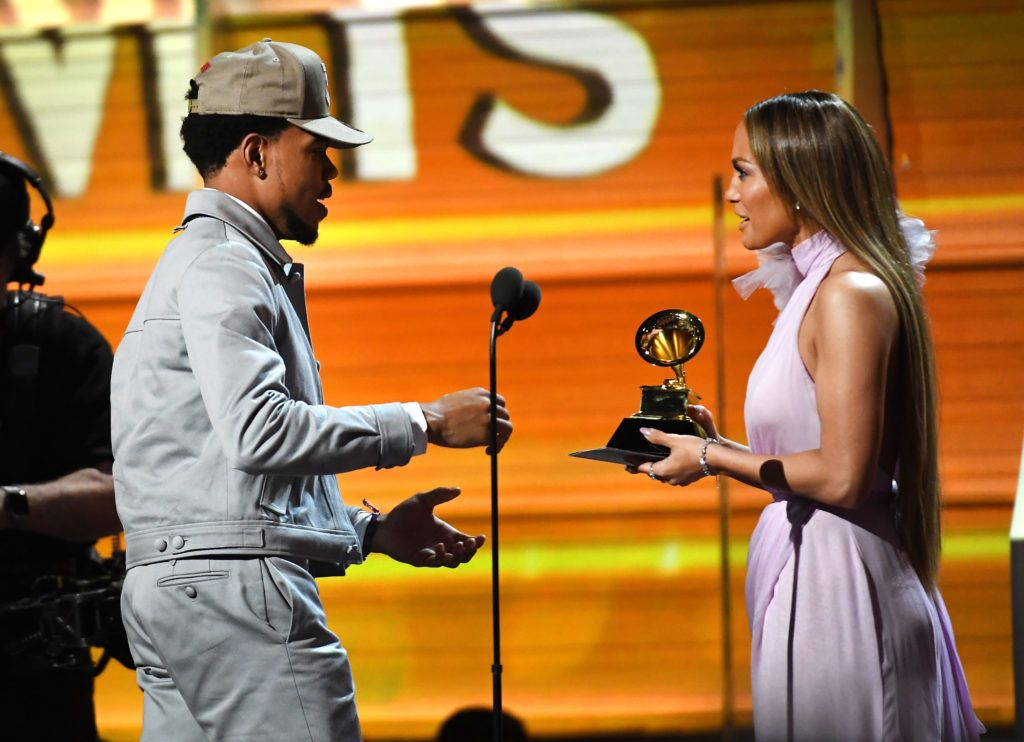 LOS ANGELES, CA - FEBRUARY 12:  Recording artist Chance the Rapper accepts the award for Best New Artist, from Jennifer Lopez onstage during The 59th GRAMMY Awards at STAPLES Center on February 12, 2017 in Los Angeles, California.  (Photo by Kevork Djansezian/Getty Images)