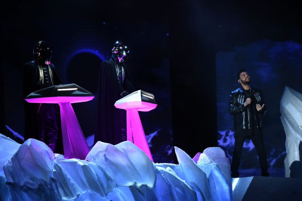 French Electro artists Daft Punk and The Weeknd (R) perform onstage during the 59th Annual Grammy music Awards on February 12, 2017, in Los Angeles, California.  / AFP / VALERIE MACON        (Photo credit should read VALERIE MACON/AFP/Getty Images)