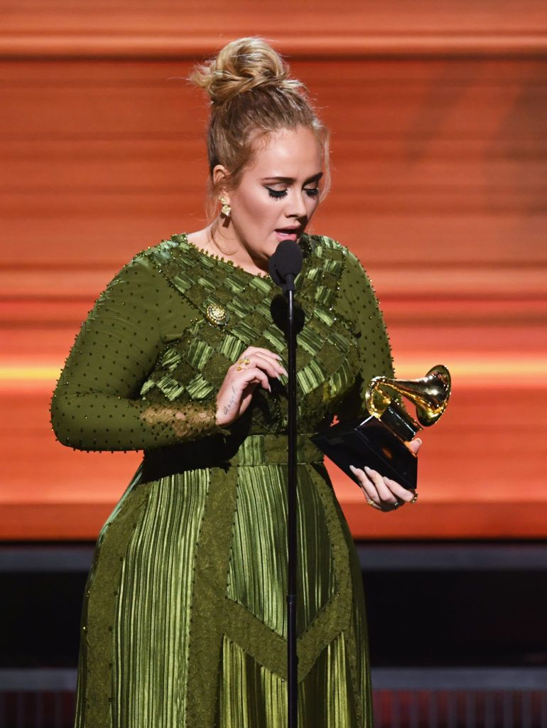 LOS ANGELES, CA - FEBRUARY 12:  Songwriter Adele Adkins accepts the Song Of The Year award for 'Hello' onstage during The 59th GRAMMY Awards at STAPLES Center on February 12, 2017 in Los Angeles, California.  (Photo by Kevin Winter/Getty Images for NARAS)