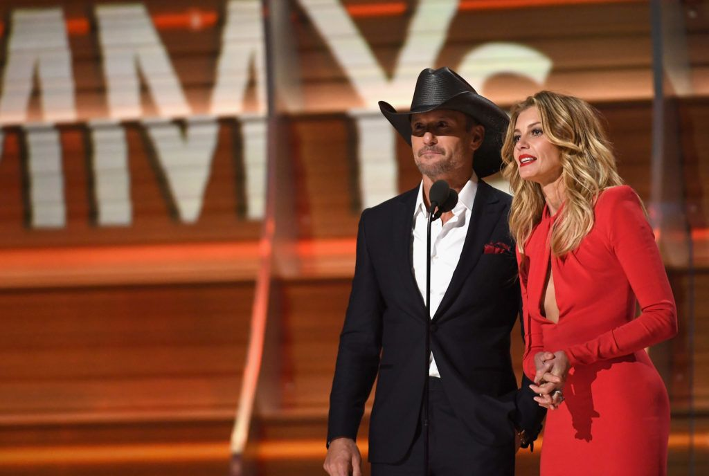 LOS ANGELES, CA - FEBRUARY 12:  Recording artists Tim McGraw (L) and Faith Hill speak onstage during The 59th GRAMMY Awards at STAPLES Center on February 12, 2017 in Los Angeles, California.  (Photo by Kevork Djansezian/Getty Images)