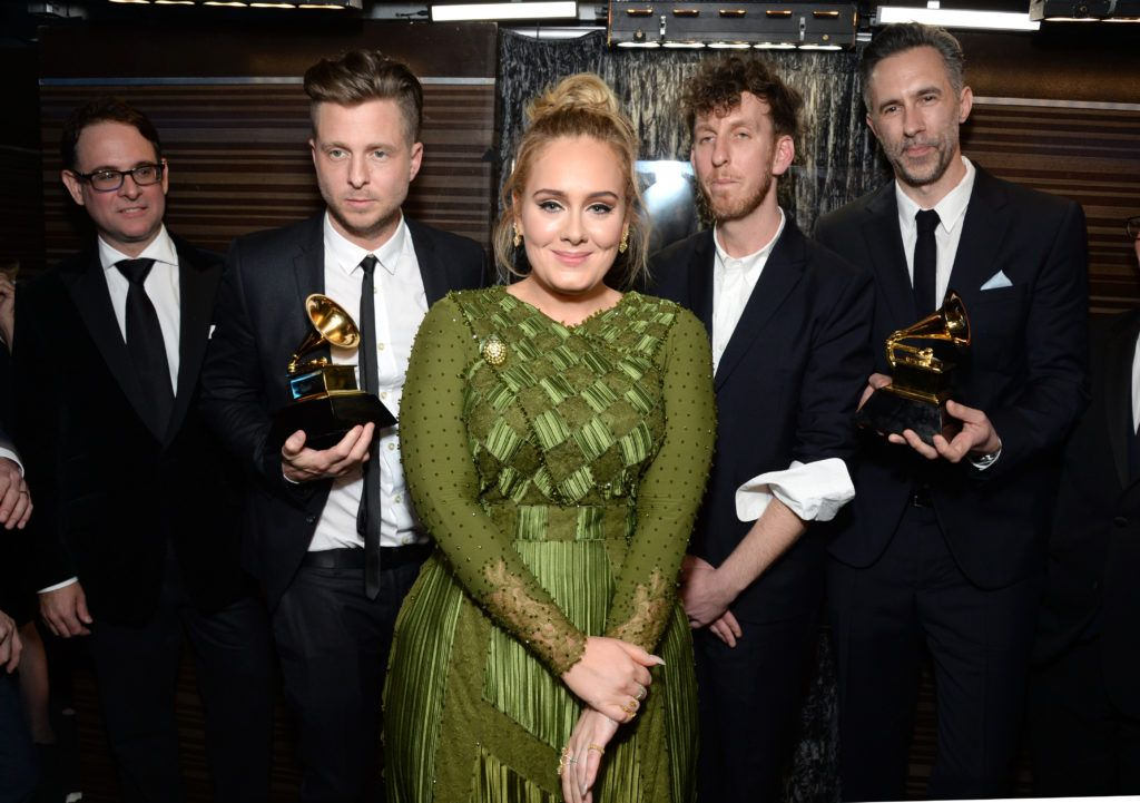 LOS ANGELES, CA - FEBRUARY 12:  Recording artist-producer Ryan Tedder (second from left), recording artist Adele (C), producer Ariel Rechtshaid (second from right), and producer Samuel Dixon (R), co-recipients of the Album Of The Year award for '25,' pose backstage during the The 59th GRAMMY Awards at STAPLES Center on February 12, 2017 in Los Angeles, California.  (Photo by Michael Kovac/Getty Images for NARAS)