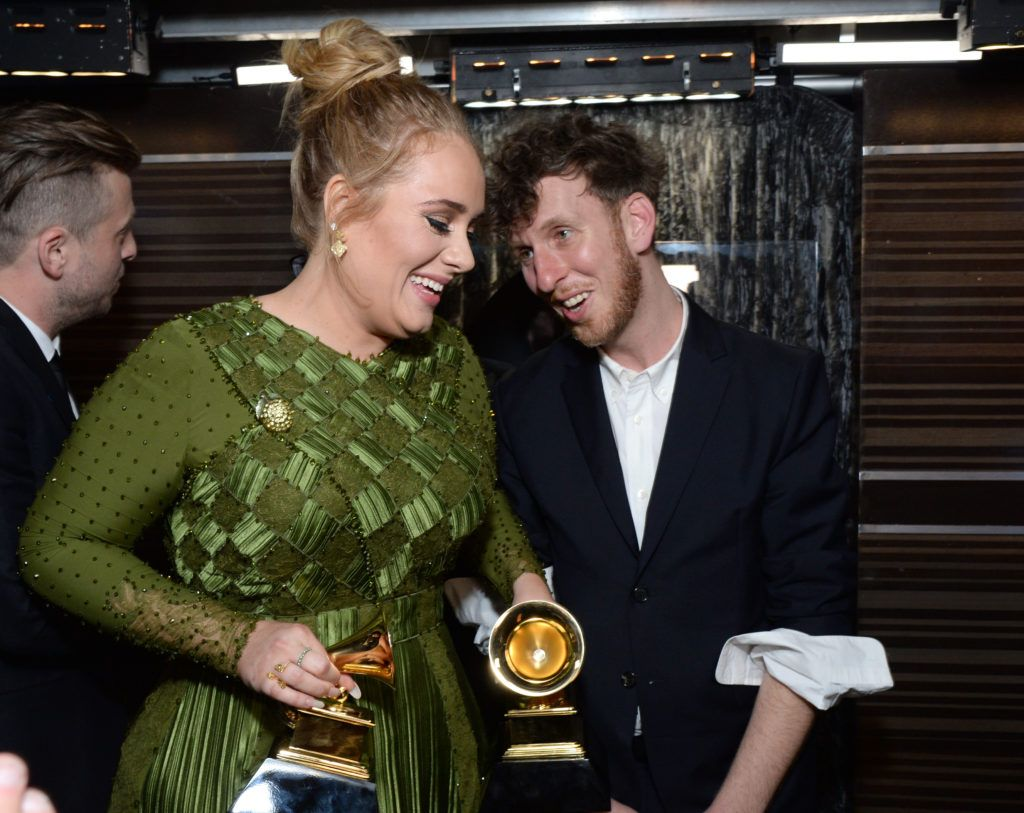 LOS ANGELES, CA - FEBRUARY 12: Recording artist Adele (L) and producer Ariel Rechtshaid (R), co-recipients of the Album Of The Year award for '25,' pose backstage during the The 59th GRAMMY Awards at STAPLES Center on February 12, 2017 in Los Angeles, California.  (Photo by Michael Kovac/Getty Images for NARAS)