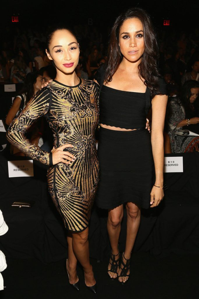 Cara Santana (L) and Meghan Markle attend the Herve Leger By Max Azria fashion show during Mercedes-Benz Fashion Week Spring 2014 at The Theatre at Lincoln Center on September 7, 2013 in New York City.  (Photo by Astrid Stawiarz/Getty Images for Mercedes-Benz Fashion Week Spring 2014)