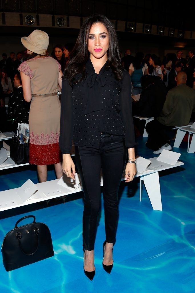 Meghan Markle attends the Tory Burch fashion show during Mercedes-Benz Fashion Week Spring at David H. Koch Theater at Lincoln Center on September 10, 2013 in New York City.  (Photo by Cindy Ord/Getty Images for Mercedes-Benz Fashion Week Spring 2014)