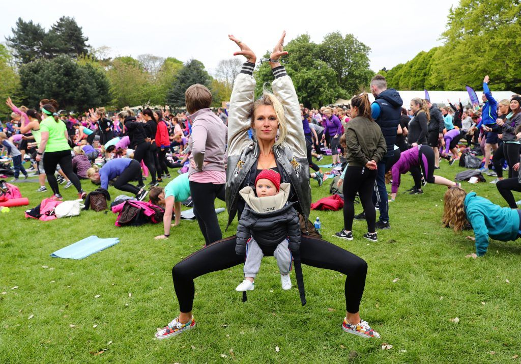 Pictured is Julietta Murrell from House of Voga, Yoga Vogueing with daughter Roxy aged 8 months as over 5,000 people descended on Dublin's Herbert park for WellFest, Ireland's only health, wellness and fitness festival. Pic: Marc O'Sullivan