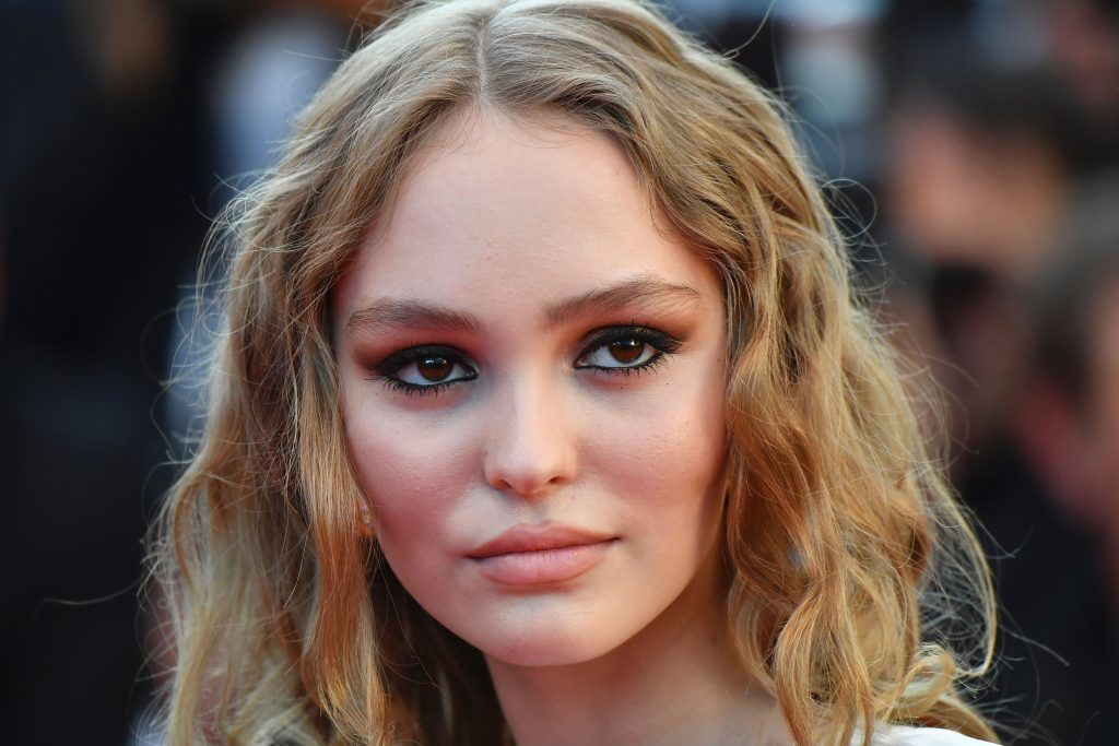 Lily-Rose Depp poses as she arrives on May 17, 2017 for the screening of the film 'Ismael's Ghosts' (Les Fantomes d'Ismael) during the opening ceremony of the 70th edition of the Cannes Film Festival in Cannes, southern France.  (Photo ALBERTO PIZZOLI/AFP/Getty Images)