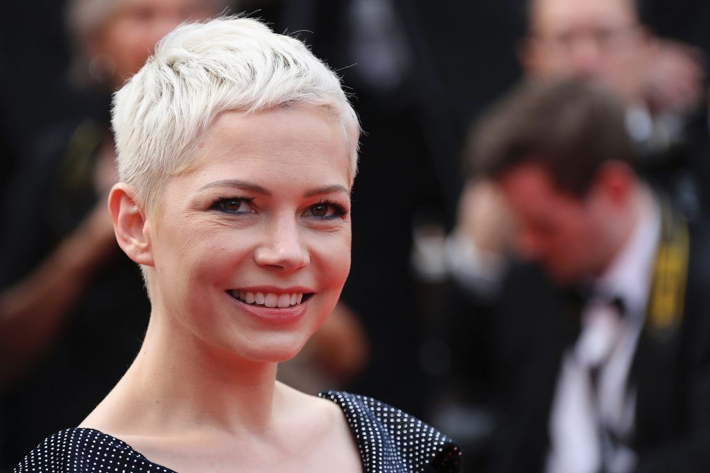 Michelle Williams smiles as she leaves on May 18, 2017 the Festival Palace after the screening of the film 'Wonderstruck' at the 70th edition of the Cannes Film Festival in Cannes, southern France. (Photo VALERY HACHE/AFP/Getty Images)