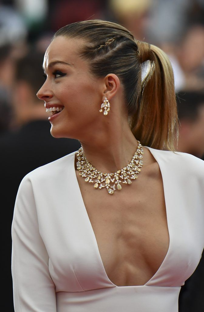 Czech model Petra Nemcova poses as she arrives on May 18, 2017 for the screening of the film 'Loveless' (Nelyubov) at the 70th edition of the Cannes Film Festival in Cannes, southern France.  (Photo ALBERTO PIZZOLI/AFP/Getty Images)