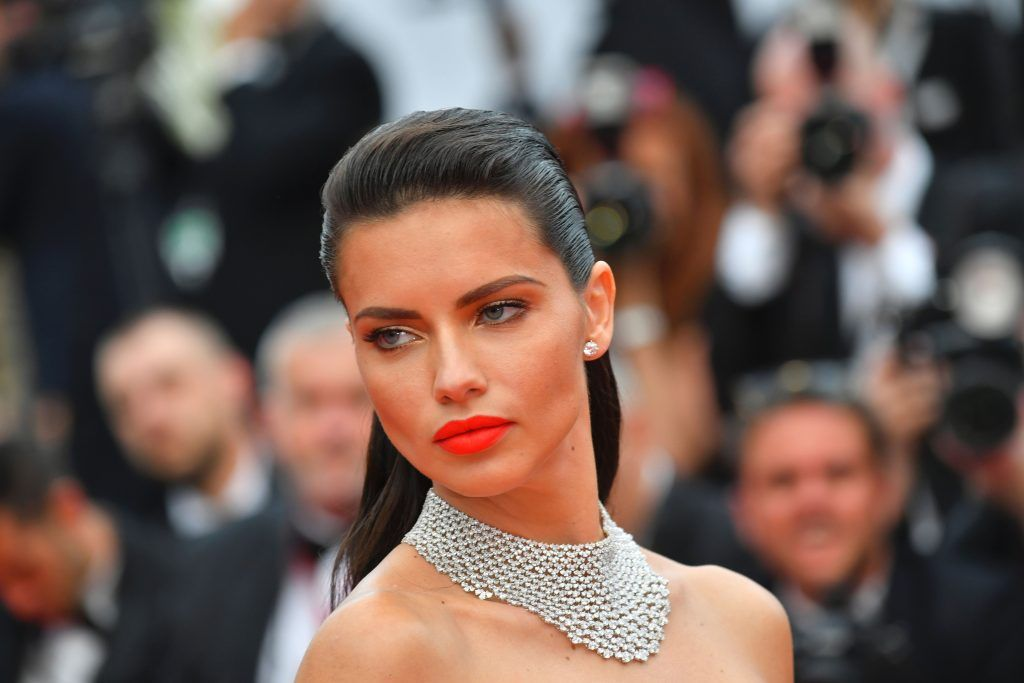 Brazilian model  Adriana Lima poses as she arrives on May 18, 2017 for the screening of the film 'Loveless' (Nelyubov) at the 70th edition of the Cannes Film Festival in Cannes, southern France.  (Photo LOIC VENANCE/AFP/Getty Images)