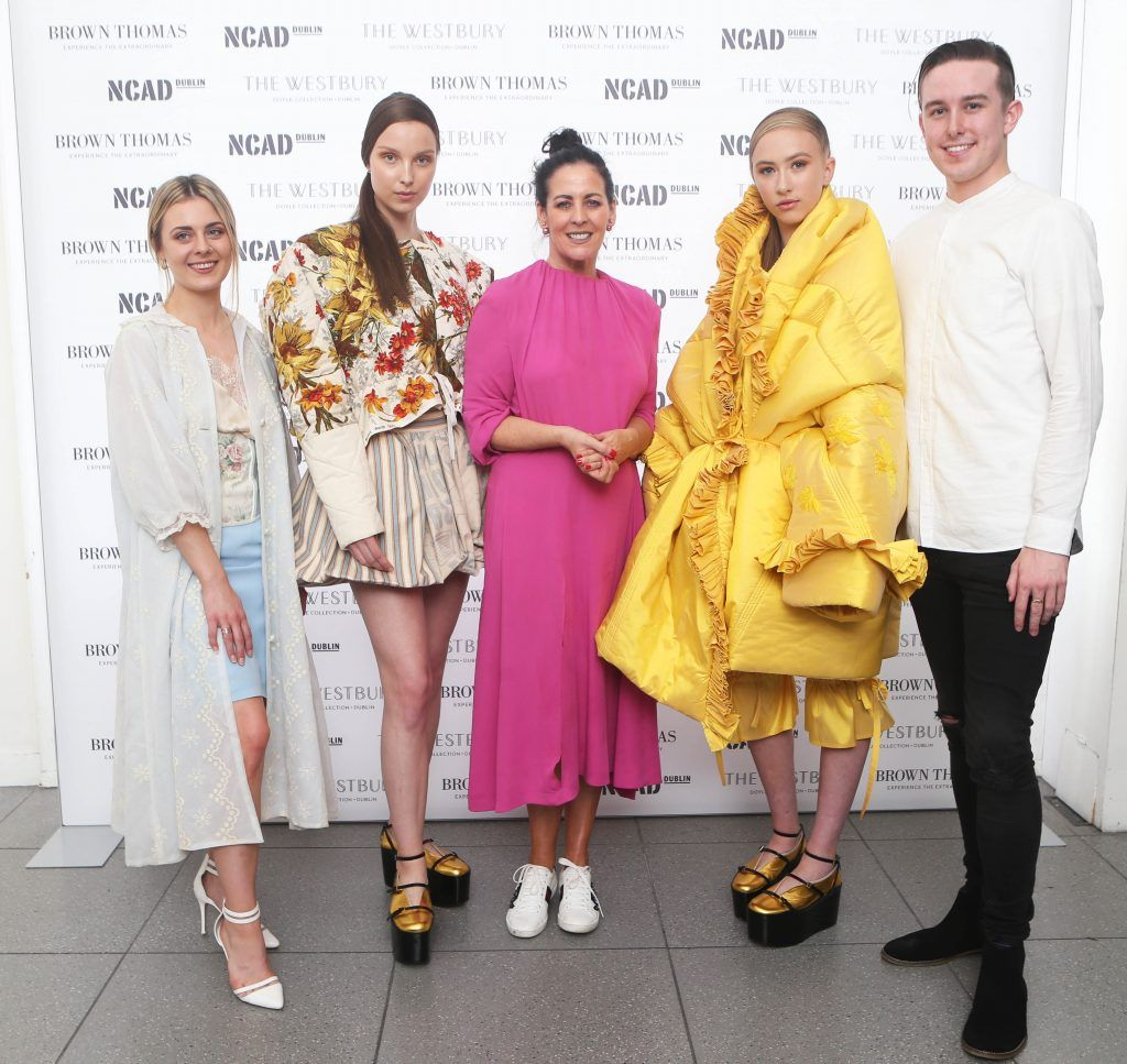 Shelly Corkery with Student Winner of the Brown Thomas bursary award Laoise Carey (left) who was chosen for the collection 'Eidolon worn by model Anastasia and Colin Burke (right) runner-up for his collection 'Born in 32' worn by model Sophie Murphy. Photo: Leon Farrell/Photocall Ireland