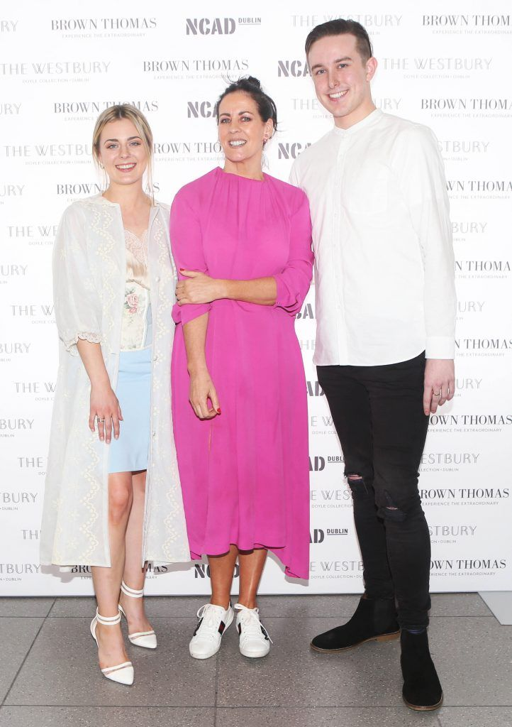 Shelly Corkery with student winner of the Brown Thomas bursary award Laoise Carey  and runner up  Colin Burke. They are pictured after at the National College of Arts and Design (NCAD)'s annual fashion show Photo: Leon Farrell/Photocall Ireland