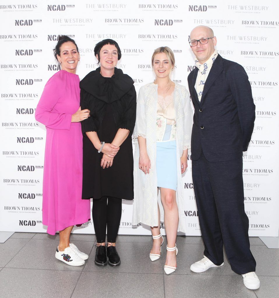 Shelly Corkery, Angela O Kelly, Alex Milton  with student winner Laoise Carey of Brown Thomas bursary award. They are pictured after the National College of Arts and Design (NCAD)'s annual fashion show. Photo: Leon Farrell/Photocall Ireland