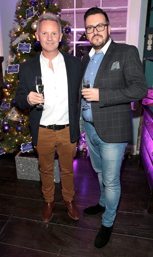 Martin Carpenter and Clyde Carroll at the Loop at Dublin and Cork Airports Joy of Giving Christmas Preview at Number 4 Parliament Street. Picture: Brian McEvoy