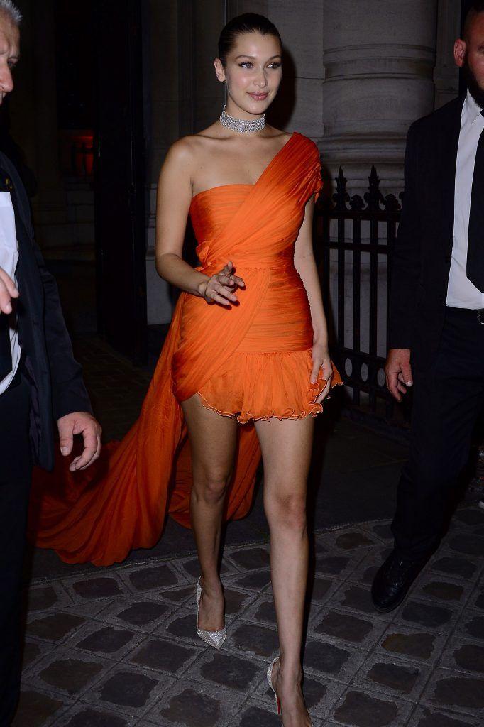 Bella Hadid leaving a Vogue party in a spectacular orange gown on 05 Jul 2017 (Photo by Radoslaw Nawrocki/WENN.com)