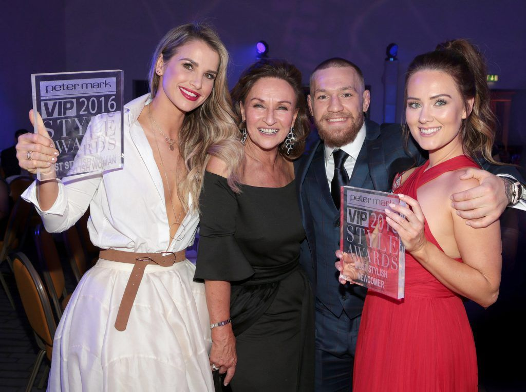 Vogue Williams  who was awarded the prize of most stylish woman,Model Boss Celia Holman Lee, Conor McGregor and his partner Dee Devlin who was awarded the prize of Most Stylish Newcomer  at The Peter Mark Vip Style Awards at The Marker Hotel in Dublin..Picture:Brian McEvoy