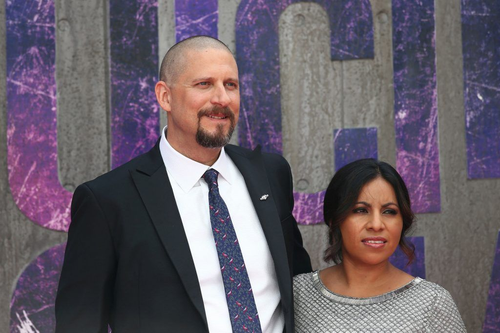 US director David Ayer (L) and his wife Maria pose as they arrive to attend the European premiere of the film Suicide Squad in central London on August 3, 2016.  / AFP / JUSTIN TALLIS        (Photo credit JUSTIN TALLIS/AFP/Getty Images)