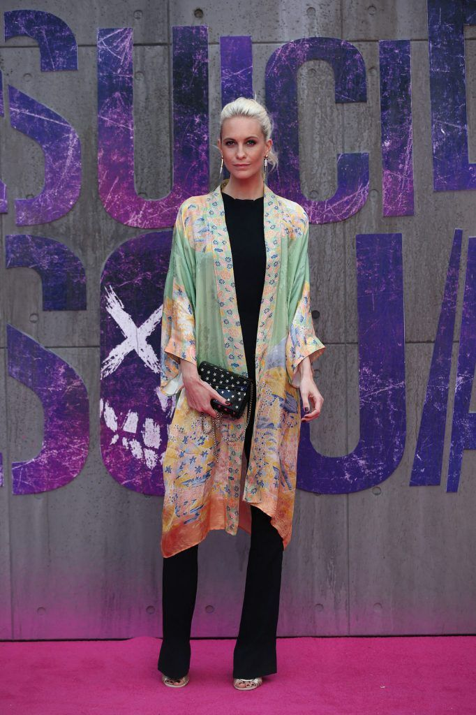 British model Poppy Delevingne poses as she arrives to attend the European premiere of the film Suicide Squad in central London on August 3, 2016.  / AFP / JUSTIN TALLIS        (Photo credit JUSTIN TALLIS/AFP/Getty Images)