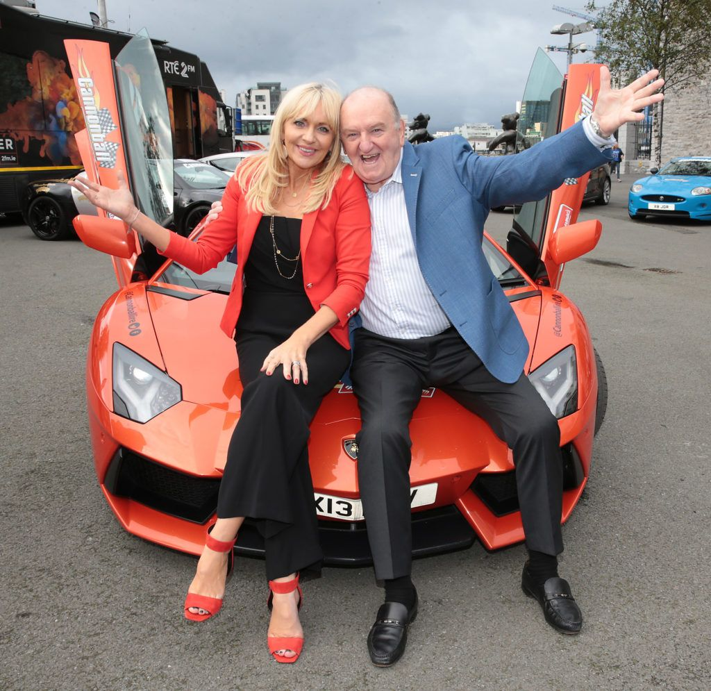 Miriam O Callaghan and George Hook at the start of the Cannonball Supercar 2016 event at Point Village Dublin. Proceeds from this year's Supercar spectacle will go to the Pieta House charity (Photo by Brian McEvoy).