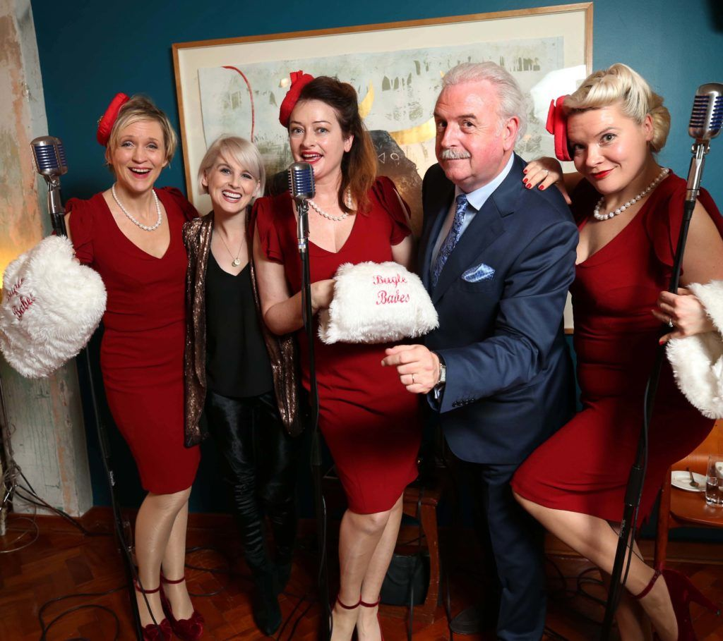 Sinead Kennedy and Marty Whelan, pictured with the Sue, Lou and Derby of the Bugle Babes at the National Lottery Christmas Lunch held in the Drury Buildings, Dublin. Pic. Robbie Reynolds