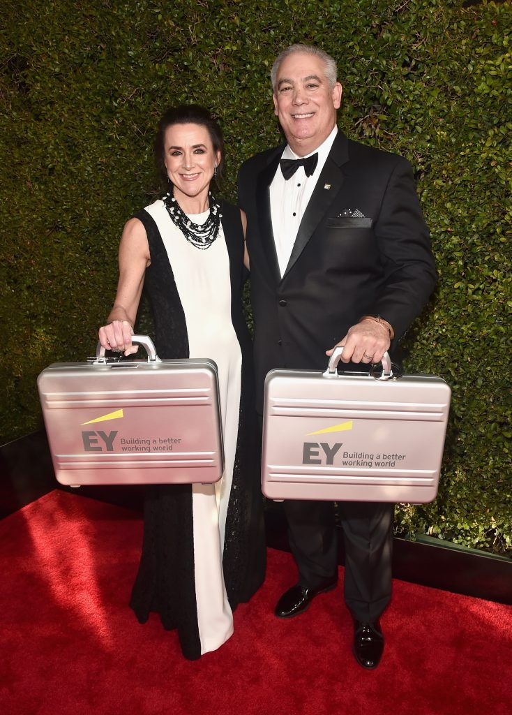 BEVERLY HILLS, CA - JANUARY 07:  Accountants from Ernst and Young with the results arrive at The 75th Annual Golden Globe Awards at The Beverly Hilton Hotel on January 7, 2018 in Beverly Hills, California.  (Photo by Alberto E. Rodriguez/Getty Images)