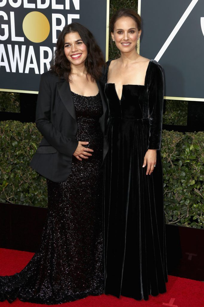 BEVERLY HILLS, CA - JANUARY 07:  Actors America Ferrera (L) and Natalie Portman attend The 75th Annual Golden Globe Awards at The Beverly Hilton Hotel on January 7, 2018 in Beverly Hills, California.  (Photo by Frederick M. Brown/Getty Images)