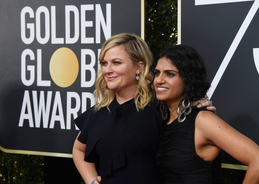 BEVERLY HILLS, CA - JANUARY 07:  Actor Amy Poehler (L) and activist Saru Jayaraman attend The 75th Annual Golden Globe Awards at The Beverly Hilton Hotel on January 7, 2018 in Beverly Hills, California.  (Photo by Frazer Harrison/Getty Images)