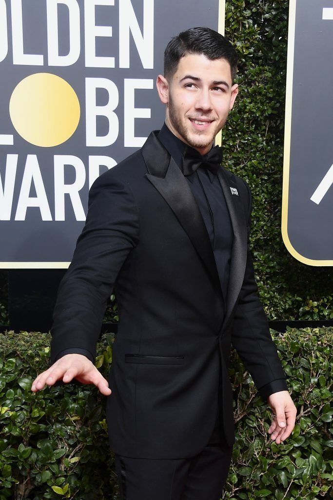 BEVERLY HILLS, CA - JANUARY 07:  Actor/singer  Nick Jonas attends The 75th Annual Golden Globe Awards at The Beverly Hilton Hotel on January 7, 2018 in Beverly Hills, California.  (Photo by Frazer Harrison/Getty Images)