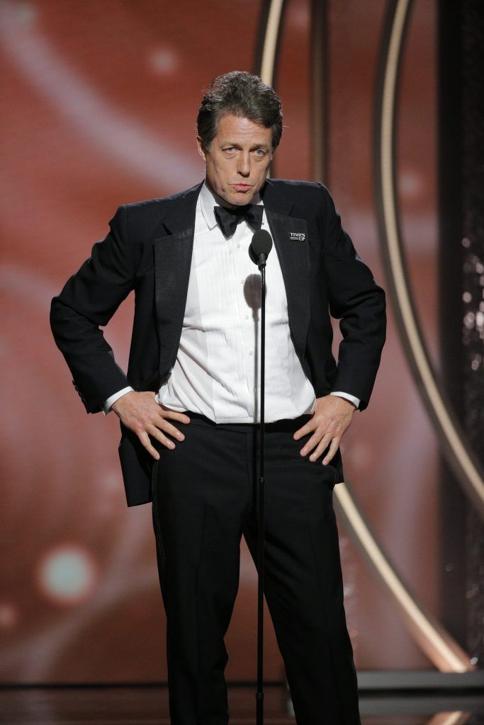 BEVERLY HILLS, CA - JANUARY 07:  In this handout photo provided by NBCUniversal,   Hugh Grant speaks onstage during the 75th Annual Golden Globe Awards at The Beverly Hilton Hotel on January 7, 2018 in Beverly Hills, California.  (Photo by Paul Drinkwater/NBCUniversal via Getty Images)