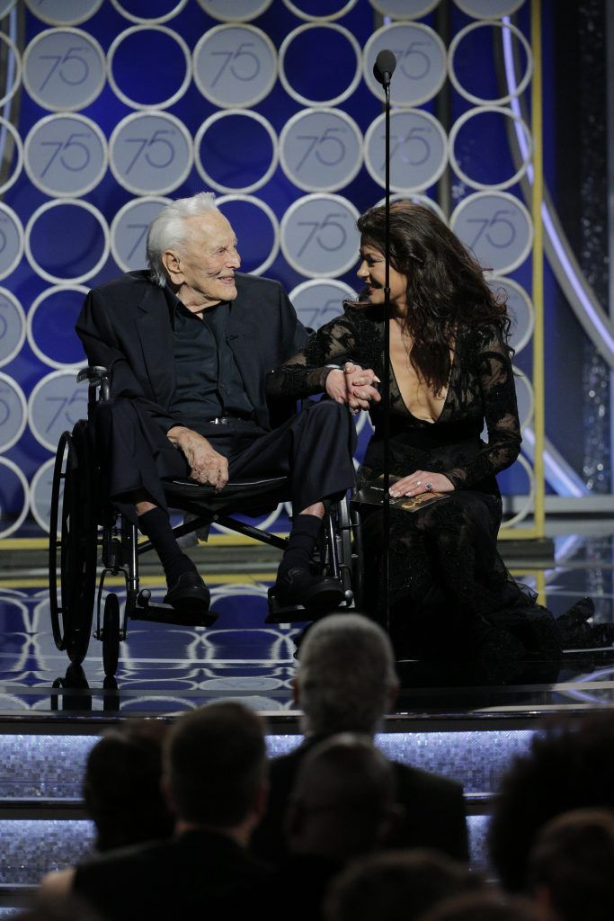 BEVERLY HILLS, CA - JANUARY 07:  In this handout photo provided by NBCUniversal, Presenters Kirk Douglas and Catherine Zeta Jones speak onstage during the 75th Annual Golden Globe Awards at The Beverly Hilton Hotel on January 7, 2018 in Beverly Hills, California.  (Photo by Paul Drinkwater/NBCUniversal via Getty Images)
