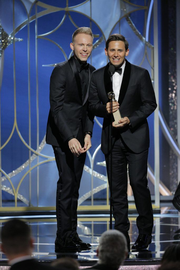 """BEVERLY HILLS, CA - JANUARY 07:  In this handout photo provided by NBCUniversal, Justin Paul and  Benj Pasek accept the award for Best Original Song – Motion Picture for """"This Is Me"""" from """"The Greatest Showman""""  during the 75th Annual Golden Globe Awards at The Beverly Hilton Hotel on January 7, 2018 in Beverly Hills, California.  (Photo by Paul Drinkwater/NBCUniversal via Getty Images)"""