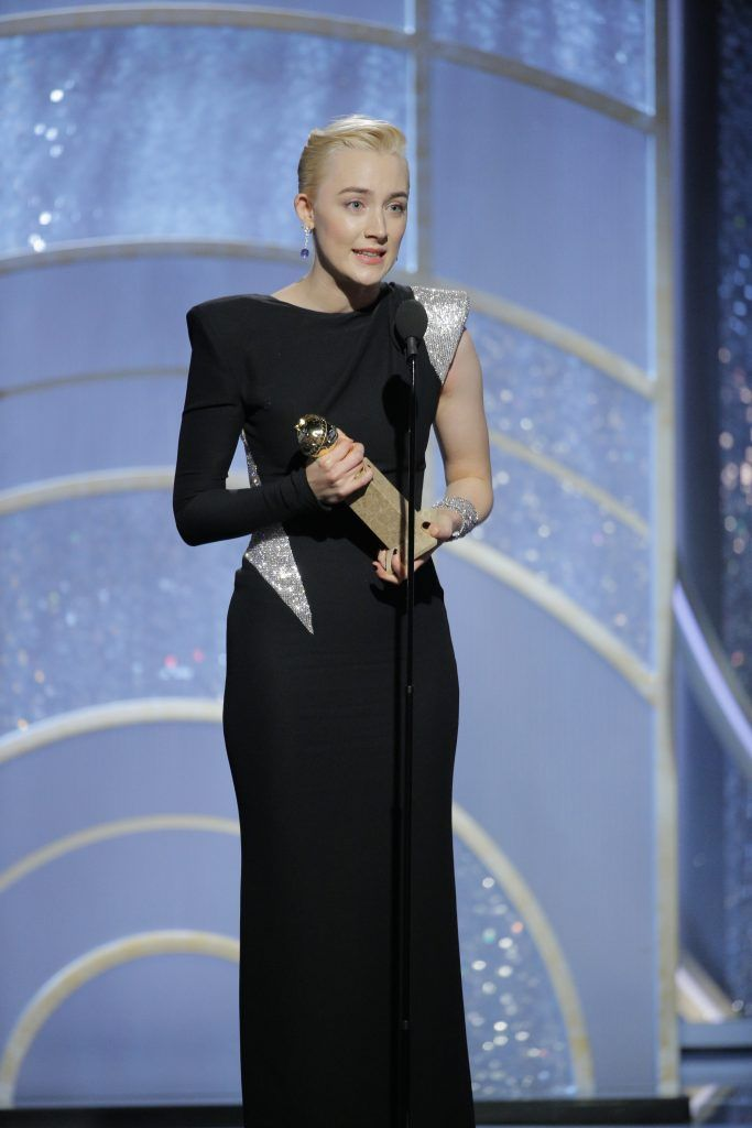 """BEVERLY HILLS, CA - JANUARY 07:  In this handout photo provided by NBCUniversal,  Saoirse Ronan accepts the award for Best Performance by an Actress in a Motion Picture – Musical or Comedy for """"Lady Bird"""" during the 75th Annual Golden Globe Awards at The Beverly Hilton Hotel on January 7, 2018 in Beverly Hills, California.  (Photo by Paul Drinkwater/NBCUniversal via Getty Images)"""