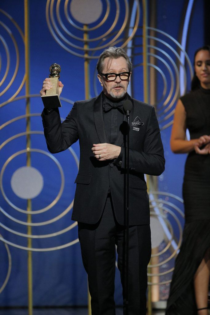 """BEVERLY HILLS, CA - JANUARY 07:  In this handout photo provided by NBCUniversal,  Gary Oldman accepts the award for Best Performance by an Actor in a Motion Picture – Drama for """"Darkest Hour""""  during the 75th Annual Golden Globe Awards at The Beverly Hilton Hotel on January 7, 2018 in Beverly Hills, California.  (Photo by Paul Drinkwater/NBCUniversal via Getty Images)"""