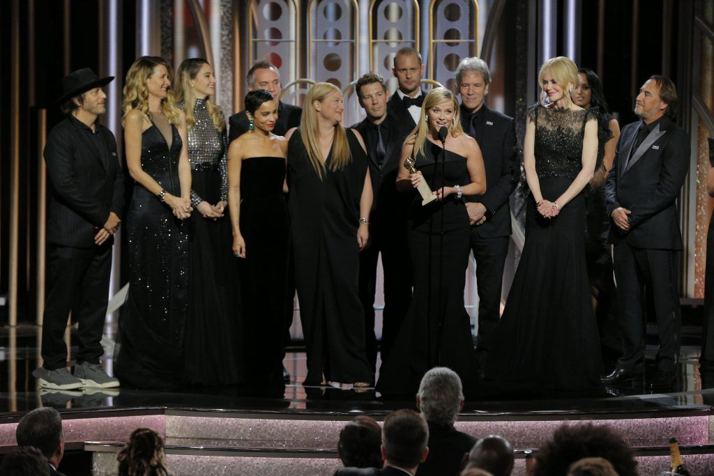 """BEVERLY HILLS, CA - JANUARY 07:  In this handout photo provided by NBCUniversal,  Reese Witherspoon accepts the award for Best Television Limited Series or Motion Picture Made for Television for  """"Big Little Lies""""  during the 75th Annual Golden Globe Awards at The Beverly Hilton Hotel on January 7, 2018 in Beverly Hills, California.  (Photo by Paul Drinkwater/NBCUniversal via Getty Images)"""