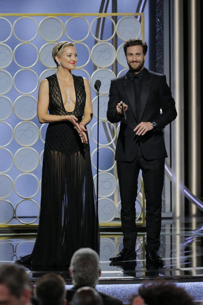 BEVERLY HILLS, CA - JANUARY 07:  In this handout photo provided by NBCUniversal, Kate Hudson and Aaron Taylor Johnson speak onstage during the 75th Annual Golden Globe Awards at The Beverly Hilton Hotel on January 7, 2018 in Beverly Hills, California.  (Photo by Paul Drinkwater/NBCUniversal via Getty Images)