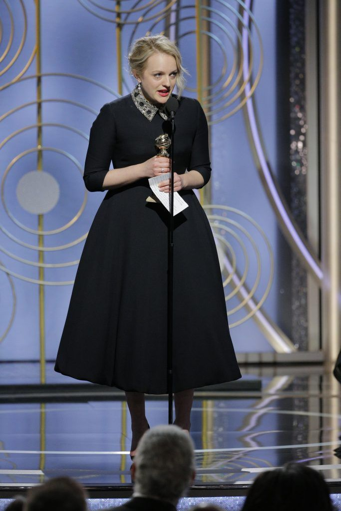 """BEVERLY HILLS, CA - JANUARY 07:  In this handout photo provided by NBCUniversal, Elisabeth Moss accepts the award for Best Performance by an Actress in a Television Series – Drama for """"The Handmaid's Tale""""  speaks onstage during the 75th Annual Golden Globe Awards at The Beverly Hilton Hotel on January 7, 2018 in Beverly Hills, California.  (Photo by Paul Drinkwater/NBCUniversal via Getty Images)"""
