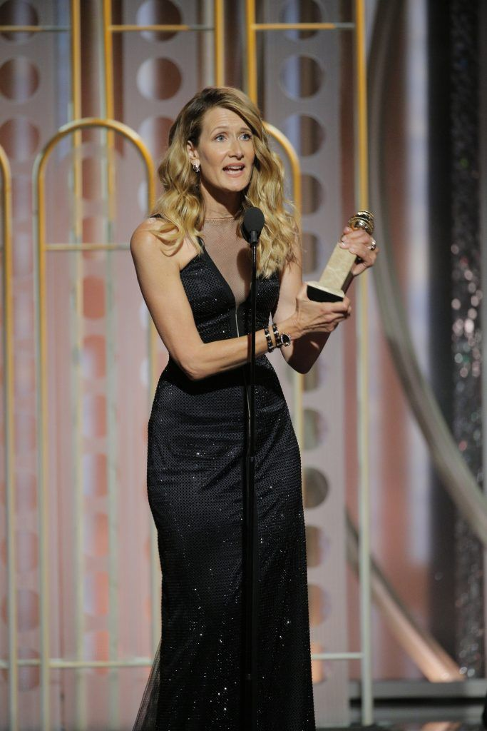 """BEVERLY HILLS, CA - JANUARY 07:  In this handout photo provided by NBCUniversal, Laura Dern accepts the award for Best Performance by an Actress in a Supporting Role in a Series, Limited Series or Motion Picture Made for Television for """"Big Little Lies""""  during the 75th Annual Golden Globe Awards at The Beverly Hilton Hotel on January 7, 2018 in Beverly Hills, California.  (Photo by Paul Drinkwater/NBCUniversal via Getty Images)"""