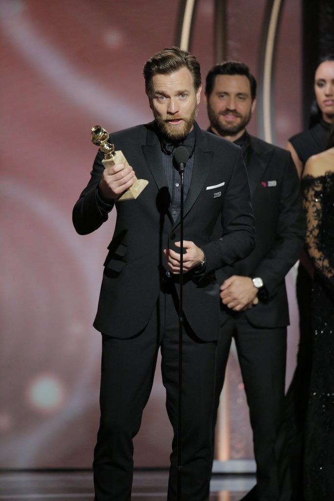 """BEVERLY HILLS, CA - JANUARY 07:  In this handout photo provided by NBCUniversal,  Ewan McGregor accepts the award for Best Performance by an Actor in a Limited Series or Motion Picture Made for Television for """"Fargo""""  during the 75th Annual Golden Globe Awards at The Beverly Hilton Hotel on January 7, 2018 in Beverly Hills, California.  (Photo by Paul Drinkwater/NBCUniversal via Getty Images)"""